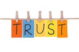 Trust, Colorful words hang on rope by wooden peg